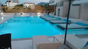 Outdoor pool, open 10 AM to 8 PM, pool umbrellas