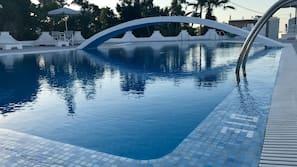 Seasonal outdoor pool, open noon to 6:00 PM, pool umbrellas