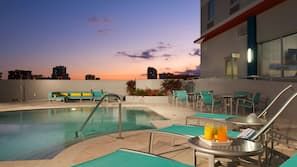 Outdoor pool, open 8:00 AM to 8:00 PM, free cabanas, sun loungers