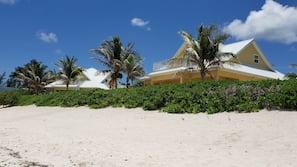 White sand, beach towels, fishing