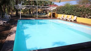 Outdoor pool, open 10 AM to 7 PM, pool umbrellas