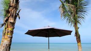 On the beach, sun-loungers, beach umbrellas, beach bar