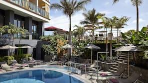 Indoor pool, 2 outdoor pools, open 10:00 AM to 8:00 PM, pool umbrellas