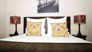 Individually decorated, blackout drapes, iron/ironing board