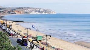 On the beach, white sand, beach shuttle, sun-loungers