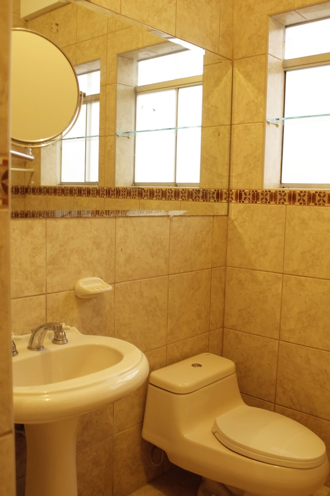 Book open guest house lima hotel deals for Z gallerie bathroom guest book