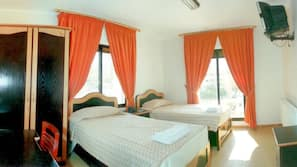 Egyptian cotton sheets, premium bedding, minibar, desk