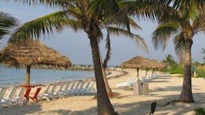 Private beach, white sand, beach towels, kayaking