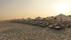 Private beach, beach umbrellas, beach towels, surfing