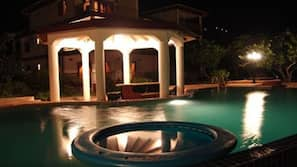 2 outdoor pools, open 9:00 AM to 9:00 PM, pool umbrellas, pool loungers