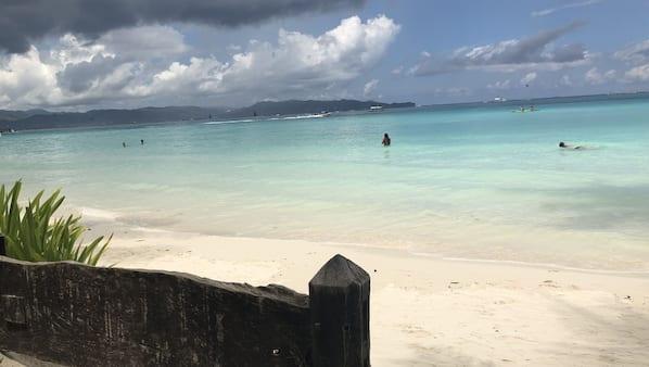 On the beach, white sand, beach shuttle, beach towels