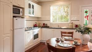 Full-sized fridge, microwave, hob, coffee/tea maker