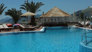 Outdoor pool, open 8 AM to 6 PM, pool umbrellas, sun loungers