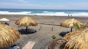 On the beach, surfing