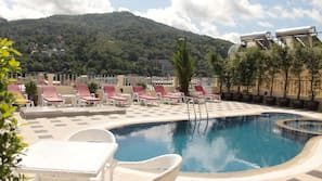 Outdoor pool, open 11:00 AM to 8:00 PM, sun loungers