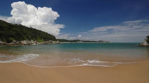 On the beach, sun loungers, beach umbrellas, beach towels