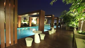 Outdoor pool, open 6:00 AM to 9:00 PM, free pool cabanas, pool umbrellas