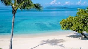 On the beach, sun loungers, beach towels, rowing