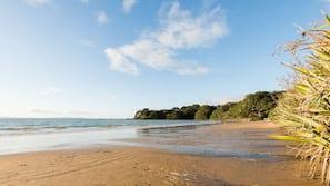 On the beach, sun-loungers, beach towels, surfing