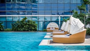Outdoor pool, open 6 AM to 9:30 PM, pool umbrellas, sun loungers