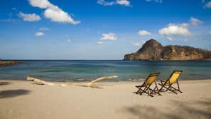 Private beach, white sand, sun loungers, beach towels