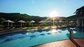 2 indoor pools, outdoor pool, open 6 AM to 8 PM, pool umbrellas
