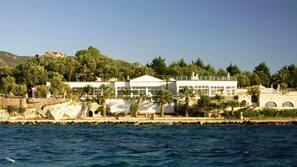 Private beach, white sand, free beach shuttle, beach cabanas