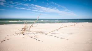 Beach nearby, white sand, sun loungers