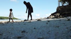 On the beach, kayaking