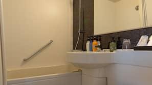 Combined shower/bathtub, free toiletries, hair dryer, slippers