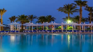 3 outdoor pools, open 9 AM to 6 PM, pool umbrellas, sun loungers