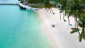 Private beach, beach umbrellas, beach towels, scuba diving