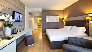 Down comforters, memory foam beds, free minibar items, in-room safe