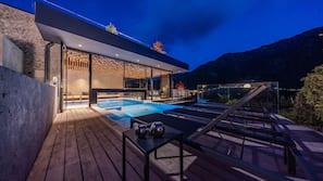 Indoor pool, outdoor pool, open 9:00 AM to 8:00 PM, pool umbrellas