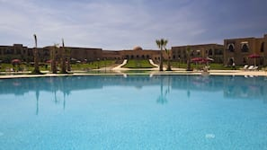 2 outdoor pools, open 10:00 AM to 6:00 PM, pool umbrellas