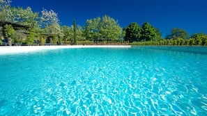 2 outdoor pools, open 9:00 AM to 6:00 PM, pool loungers