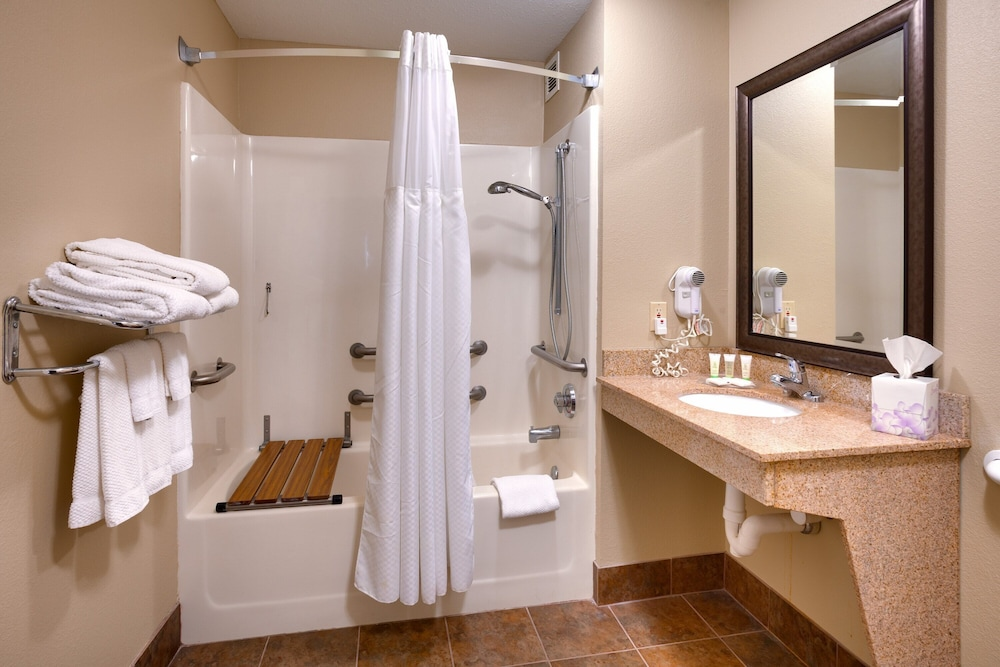 Bathroom, King Suite. Free Breakfast. Offsite Pool Access. Gym. Near Mercy Hospital Northwest Arkansas!