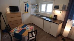 Fridge, microwave, hob, cookware/dishes/utensils