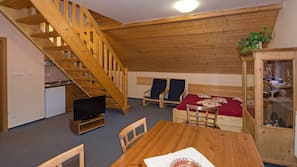 Flat-screen TV, fireplace, table tennis table