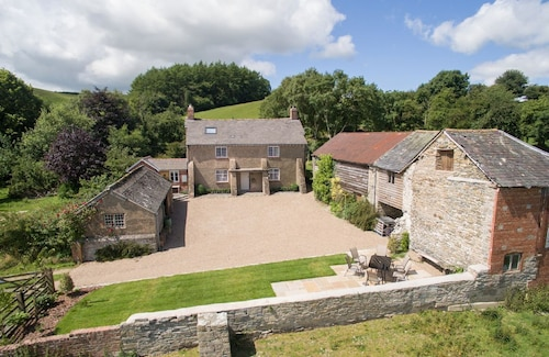 A Beautifully Refurbished Detached Farmhouse in an Elevated Position Enjoying Breath-taking Unspoilt Views Across the Valley Towards the Kerry Ridgeway and Shropshire Hills but Within 2 Miles of the Ancient Welsh Border Town of Montgomery