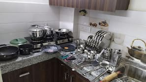 Full-size fridge, stovetop, rice cooker, cookware/dishes/utensils