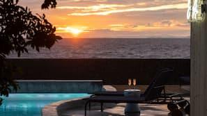 Outdoor pool, open 3:00 PM to 8:00 PM, pool umbrellas