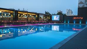 Seasonal outdoor pool, open 1:00 PM to 5:00 PM, pool umbrellas