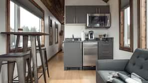 Mini-fridge, microwave, stovetop, coffee/tea maker