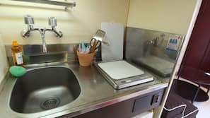Fridge, stovetop, electric kettle, cookware/dishes/utensils