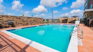 Outdoor pool, open 8:00 AM to 10:00 PM, pool umbrellas