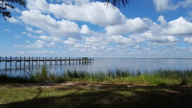 January and Feb 2021 still available! Two homes! Bayfront w/ dock! Over 7 acres!