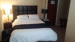 Desk, iron/ironing board, bed sheets