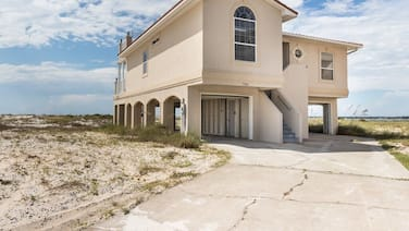 Partial Gulf View! Spiral Staircase Roof Access, Covered Parking, Boat Parking!
