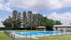 Seasonal outdoor pool, open noon to 8:00 PM, lifeguards on site